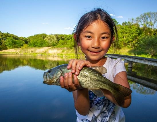 Little girl with a fish
